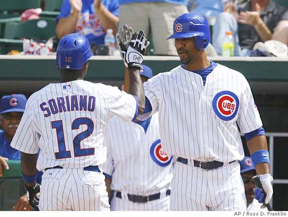 Chicago Cubs center fielder Alfonso Soriano, left, is congratulated by teammate Derrek Lee, right, after Soriano's third inning 2-run home run against the Colorado Rockies in their spring training baseball game, Wednesday, March 28, 2007, in Mesa, Ariz. (AP Photo/Ross D. Franklin) EFE OUT Photo: Ross D. Franklin