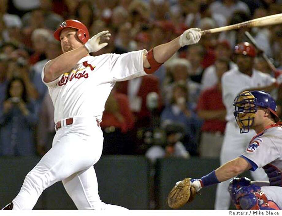 STL03D:SPORT-BASEBALL:ST. LOUIS,8SEP98 - St. Louis Cardinals Mark McGwire watches the ball clear the left field fence as he hits his record breaking 62nd home run in front of Chicago Cubs catcher Scott Servais in the fourth inning of their game September 8. McGwire broke the record held by Roger Maris. gmh/Photo by Mike Blake REUTERS Mark McGwire used androstenedione during the 1998 season, when he hit his record-breaking 62nd home run and eight more. Ran on: 03-09-2005  Jose Canseco Ran on: 03-09-2005  Jose Canseco Photo: MIKE BLAKE