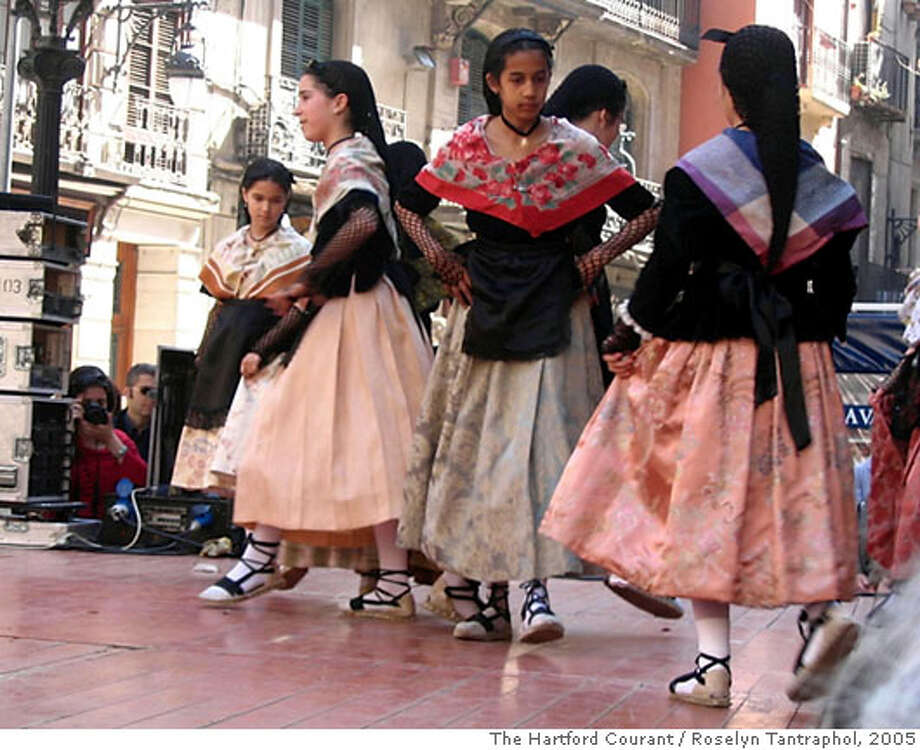 Children from a local dance school perform a traditional Catalan dance during Festes de Sant Josep Oriol, a three-day celebration in Barcelona. Illustrates TRAVEL-BARCELONA (category t) by Roselyn Tantraphol � 2005, The Hartford Courant. Moved Tuesday, July 19, 2005. (MUST CREDIT: The Hartford Courant photo by Roselyn Tantraphol.) Photo: ROSELYN TANTRAPHOL