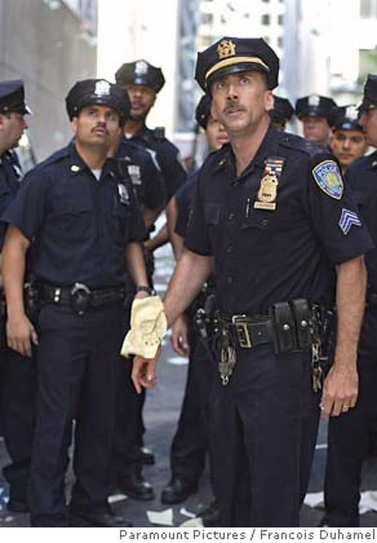 """In this photo provided by Paramount Pictures, Michael Pea as Will Jimeno (left); and Nicolas Cage as John McLoughlin (right) in """"World Trade Center."""" (AP Photo/Paramount Pictures/Francois Duhamel)"""