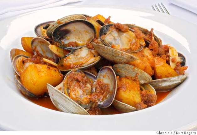 Portuguese-style clams with chorizo, white wine and potatoes. Chronicle photo by Kurt Rogers
