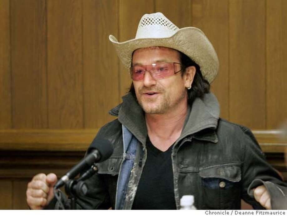 bono_038_df.JPG  U2 singer, Bono, arrives at the San Francisco Chronicle to speak to the editorial board, reporters and editors.  Deanne Fitzmaurice / San Francisco Chronicle Ran on: 12-19-2005  Bill Gates,top left, his wife, Melinda, top right, and rock star Bono were praised for &quo;being shrewd about doing good.&quo; Photo: Deanne Fitzmaurice