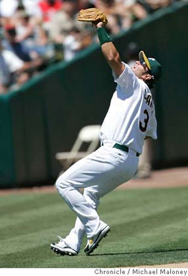 Oakland's Eric Chavez gets under a David Ortiz 7th inning foul ball for an out.  Oakland Athletics vs Boston Red Sox at McAfee Coliseum in Oakland. Oakland won 5-1.  Photo by Michael Maloney / San Francisco Chronicle on 7/26/06 in Oakland,CA MANDATORY CREDIT FOR PHOTOG AND SF CHRONICLE/ -MAGS OUT Photo: Michael Maloney