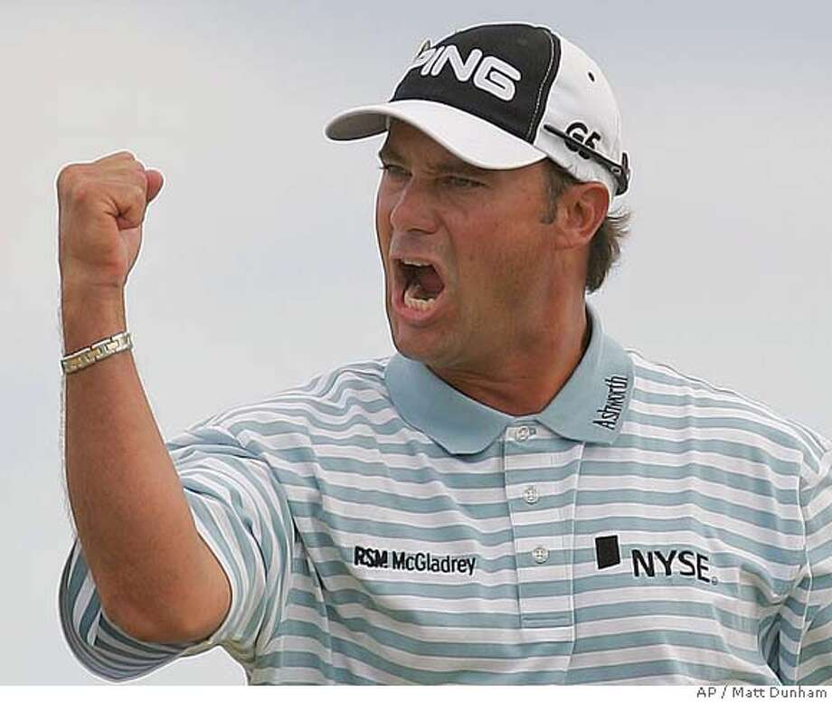 Chris DiMarco of the United States reacts after holing a putt to save par on the 14th hole during the final round of the British Open Golf Championship at the Royal Liverpool Golf Course in Hoylake, England Sunday July 23, 2006. (AP Photo/Matt Dunham) Photo: MATT DUNHAM
