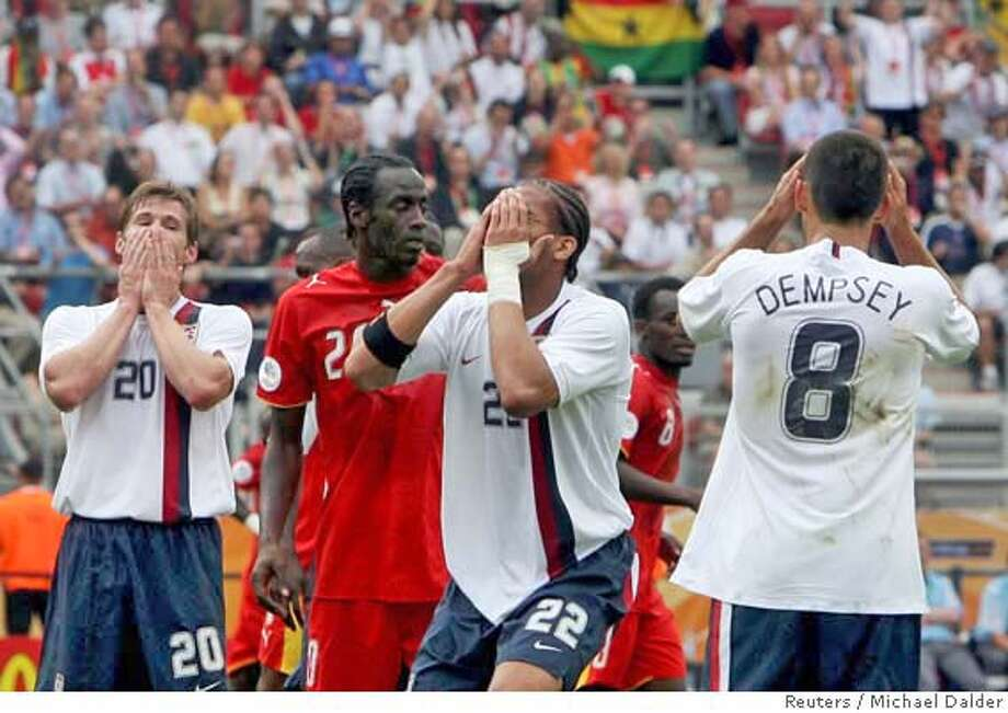 McBride, Onyewu and Dempsey of the US react to a missed scoring opportunity in Nuremberg Photo: MICHAEL DALDER