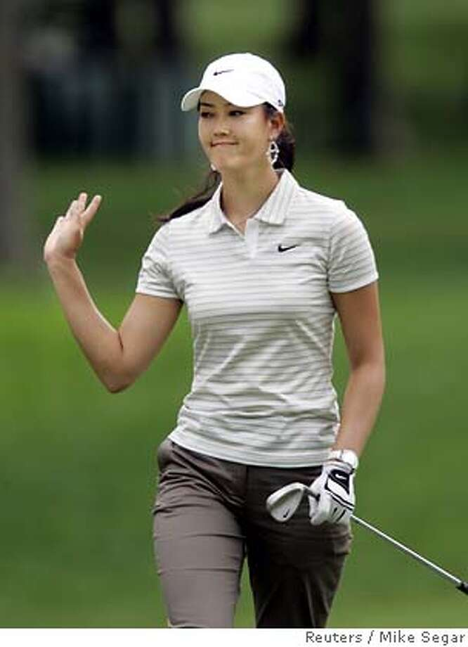 Michelle Wie waves to gallery during U.S.Open Sectional Qualifying Round in New Jersey Photo: MIKE SEGAR