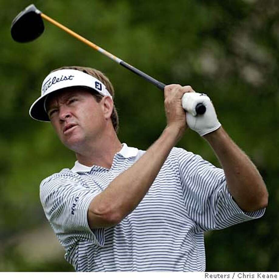 Davis Love III watches his drive during Wachovia golf championship in Charlotte Photo: CHRIS KEANE