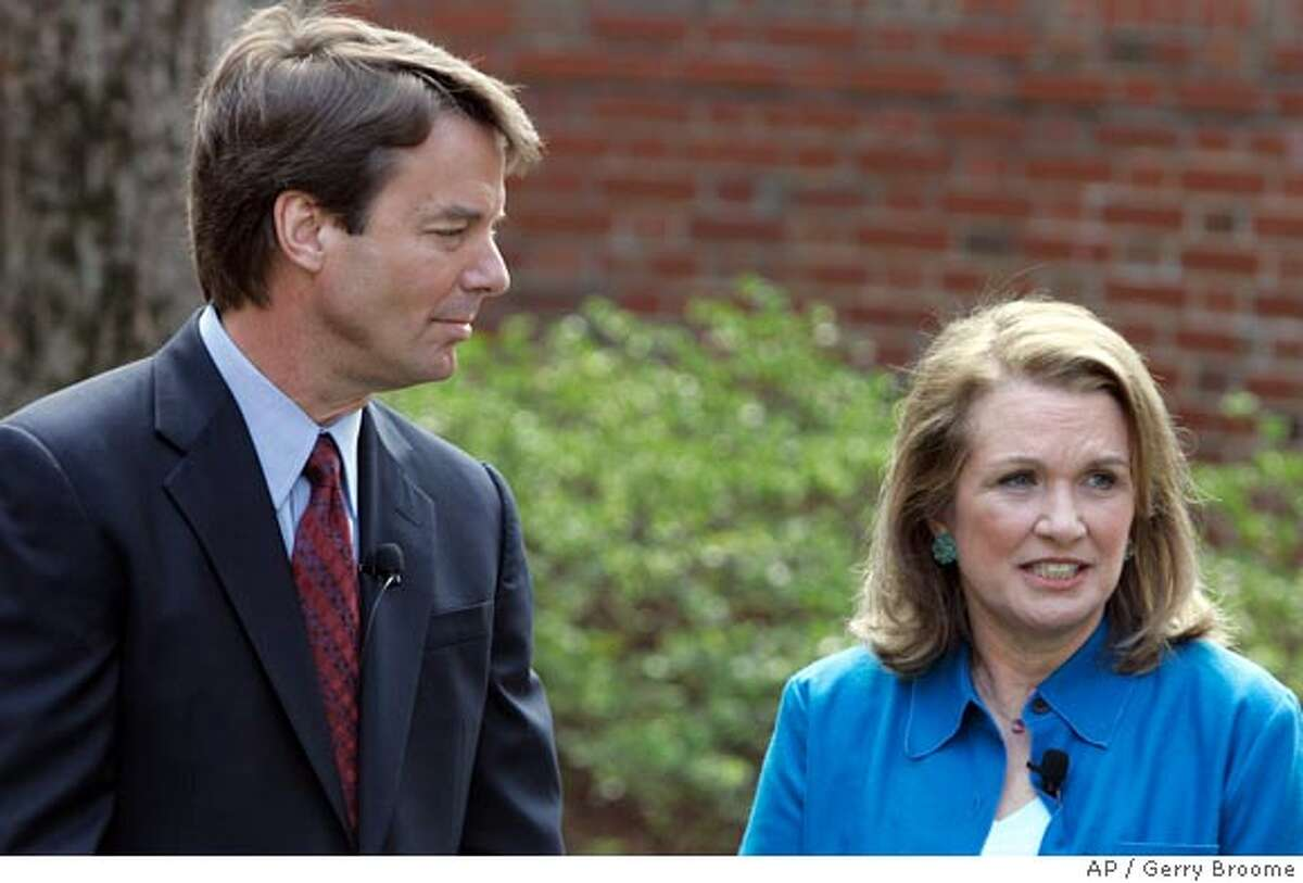Democratic Presidential hopeful John Edwards, left, listens to his wife Elizabeth speak about her recurrence of cancer during a news conference in Chapel Hill, N.C., Thursday, March 22, 2007. Edwards will continue his campaign for the presidency. (AP Photo/Gerry Broome)