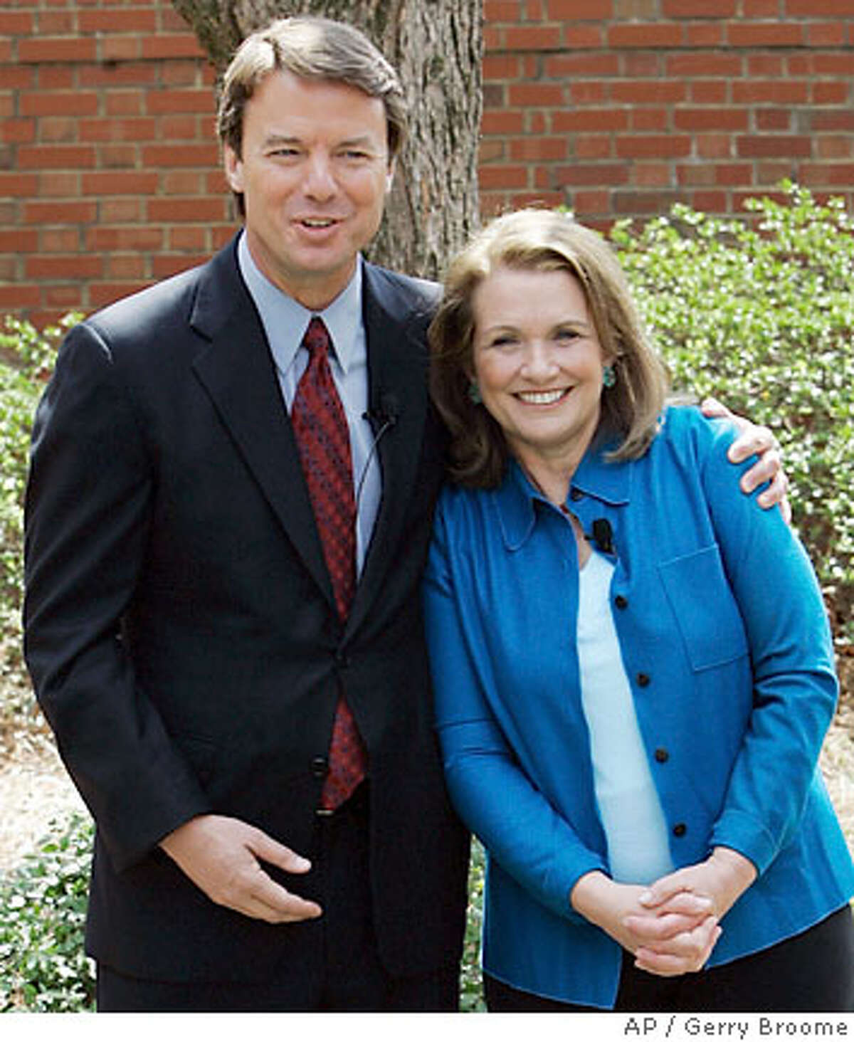 Democratic Presidential hopeful John Edwards hugs his wife Elizabeth while they speak about Elizabeth's recurrence of cancer during a news conference in Chapel Hill, N.C., Thursday, March 22, 2007. Edwards will continue his campaign for the presidency. (AP Photo/Gerry Broome)