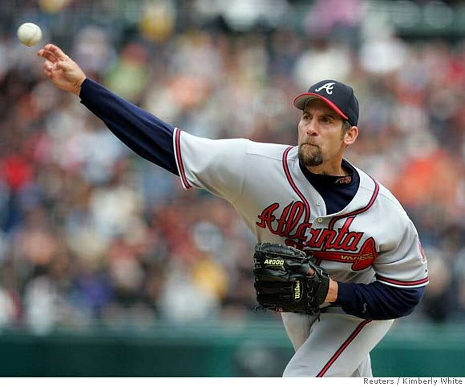 Atlanta Braves starter John Smoltz delivers against the San Francisco Giants in the first inning in San Francisco, California, April 9, 2006. REUTERS/Kimberly White 0 Photo: KIMBERLY WHITE