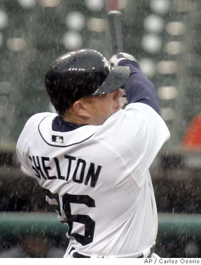 Detroit Tigers' Chris Shelton hits a home run with Magglio Ordonez on second base, in the ninth inning of the baseball game against the Chicago White Sox in Detroit, Wednesday, April 12, 2006. The White Sox defeated the Tigers 4-3. (AP Photo/Carlos Osorio) EFE OUT Photo: CARLOS OSORIO