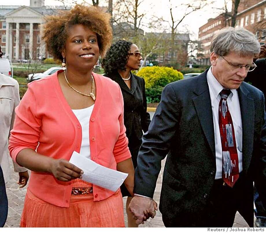Representative Cynthia McKinney (L) (D-GA) arrives for a news conference with her attorney Michael Raffauf after an altercation with a Capitol Hill police officer earlier in the week in Washington March 31, 2006. McKinney is waiting to learn if she would be charged for apparently striking an officer after she entered a House office building earlier this week unrecognized and did not stop when asked. REUTERS/Joshua Roberts Photo: JOSHUA ROBERTS