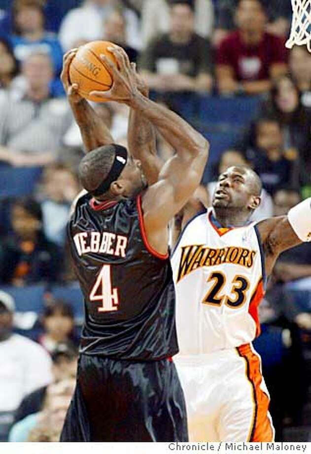 WARRIORS_066_MJM.jpg  76ers Chris Webber goes up for a shot defended by Warriors Jason Richardson in the 1st half. Warriors won 98-89.  Golden State Warriors vs Philadelphia 76ers at the Arena in Oakland.  Photo by Michael Maloney / San Francisco Chronicle on 3/19/06 in Oakland,CARan on: 03-20-2006  Jason Richardson wants to be an All-Star and an Olympian. But first he says he needs to help his team win. He did his part Sunday, defending Chris Webber in the Warriors' win over 76ers.Ran on: 03-20-2006  Jason Richardson wants to be an All-Star and an Olympian. But first he says he needs to help his team win. He did his part Sunday, defending Chris Webber in the Warriors' win over 76ers. Photo: Michael Maloney