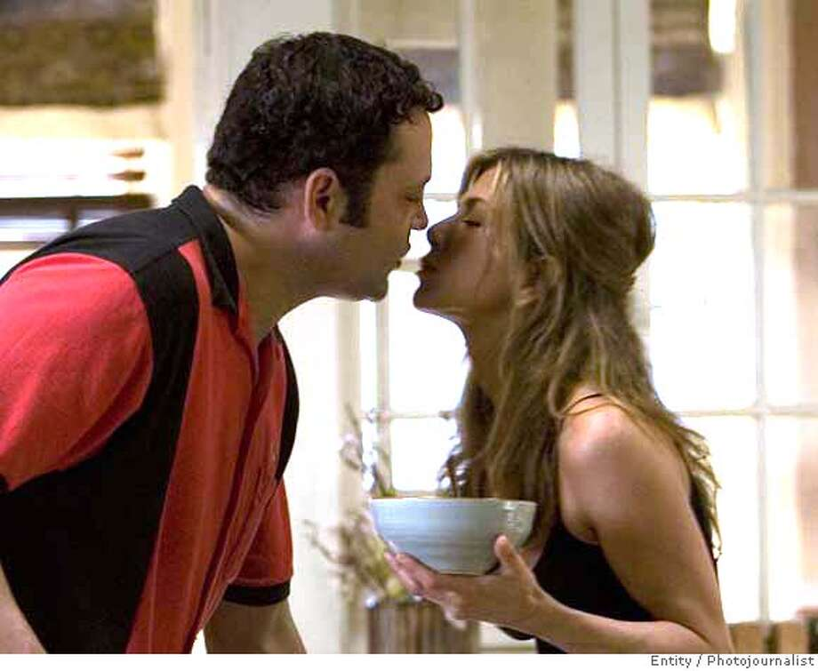 "Bus tour guide Gary Grobowski (VINCE VAUGHN) and art dealer Brooke Meyers (JENNIFER ANISTON) prepare for a family dinner in the romantic comedy ""The Break-Up"". ""The Break-Up"" will be released in theaters on June 2, 2006. Credit: Melissa Moseley/UNIVERSAL STUDIOS Photo: Credit: Melissa Moseley"