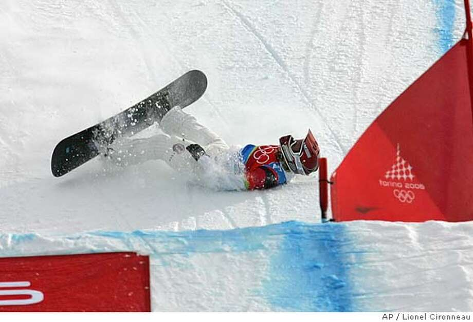 American Lindsey Jacobellis who was leading in the final of the Women's Snowboard Cross competition, crashes in sight of the finish at the Turin 2006 Winter Olympic Games in Bardonecchia, Italy, Friday, Feb. 17, 2006. Tanja Frieden of Switzerland won the race to take the gold medal, Jacobellis finished second to take the silver medal, and Dominique Maltais of Canada bronze. (AP Photo/Lionel Cironneau) Photo: LIONEL CIRONNEAU