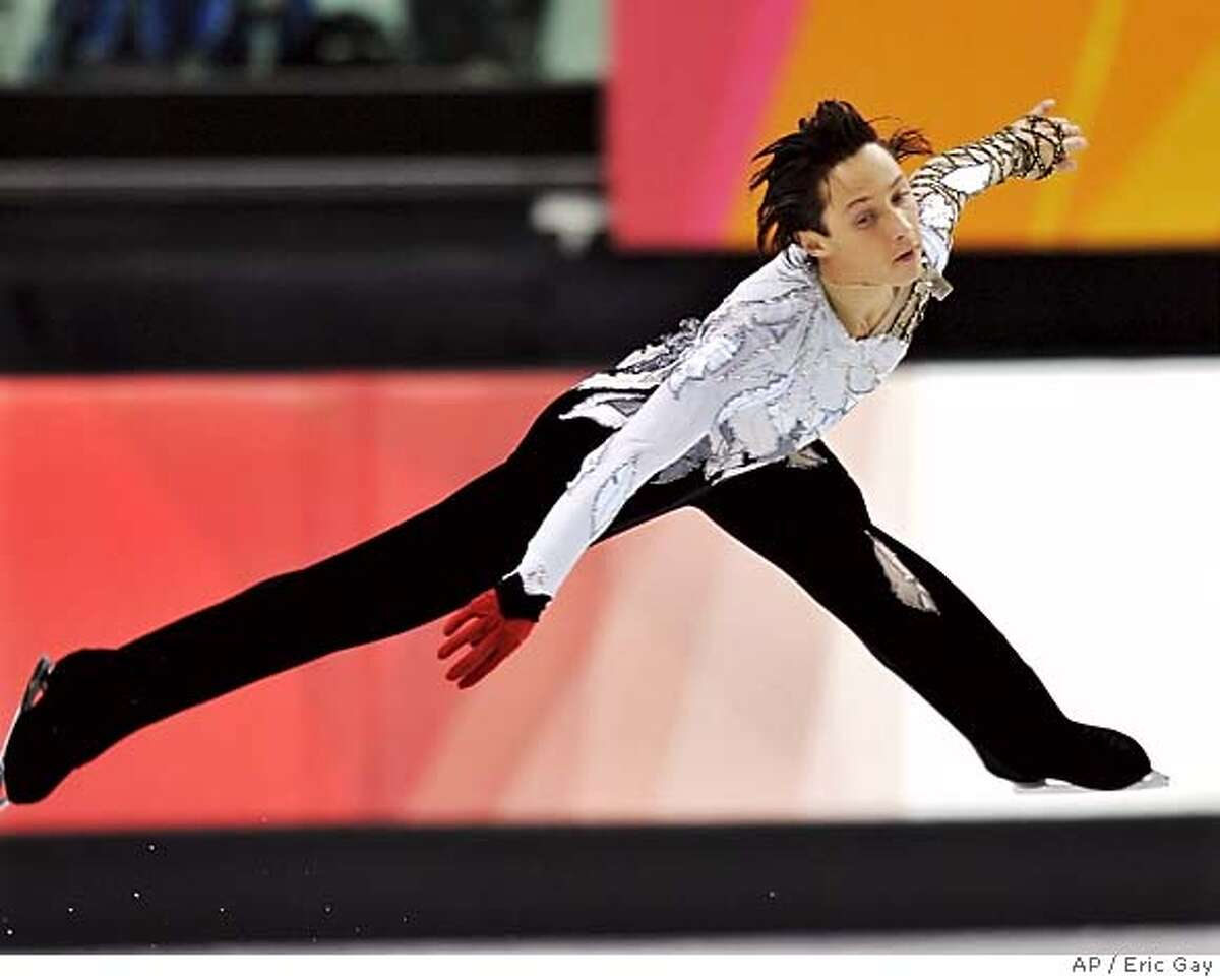 United States' Johnny Weir performs a flying spin during the Men's Figure Skating short program at the Turin 2006 Winter Olympic Games in Turin, Italy, Tuesday, Feb. 14, 2006. (AP Photo/Eric Gay)
