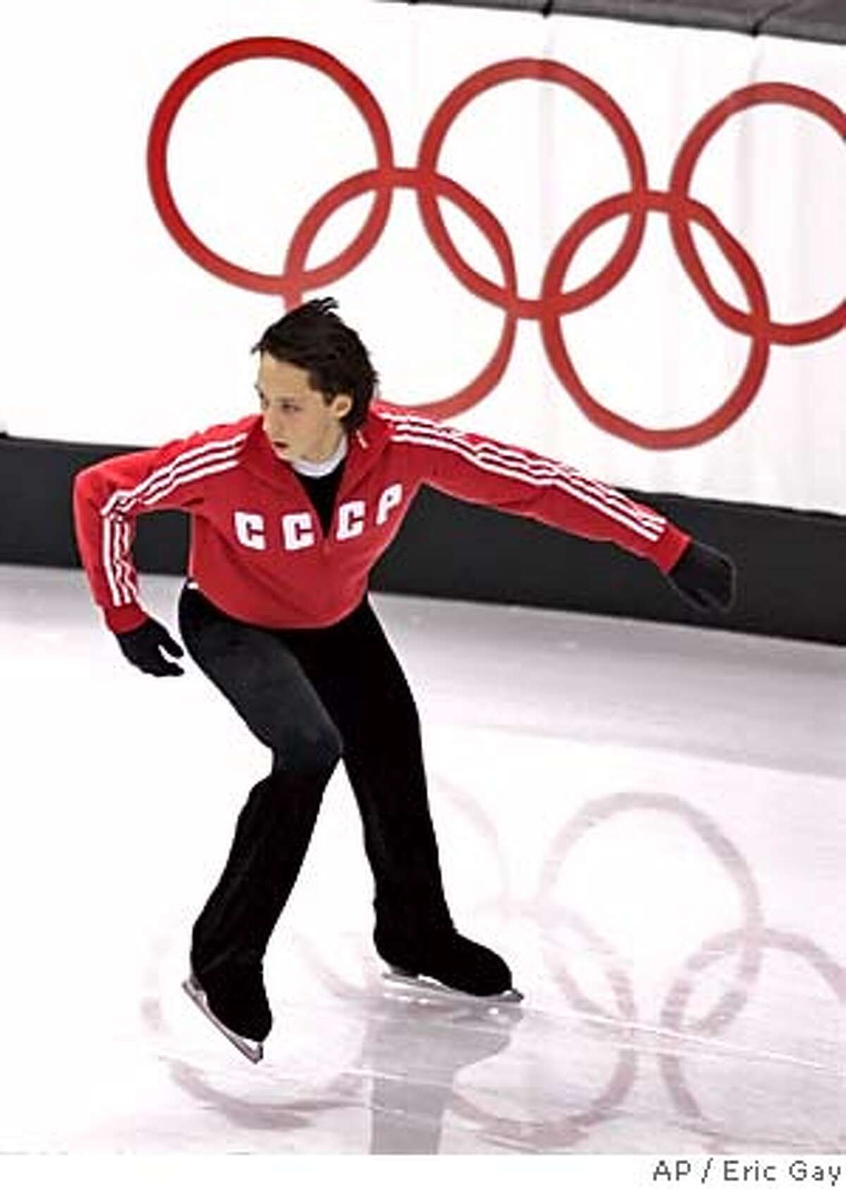 Wearing a Soviet jacket, United States 2006 figure skating champion Johnny Weir practices his routine during a training session at the Turin 2006 Winter Olympic Games in Turin, Italy, Sunday, Feb. 12, 2006. (AP Photo/Eric Gay)