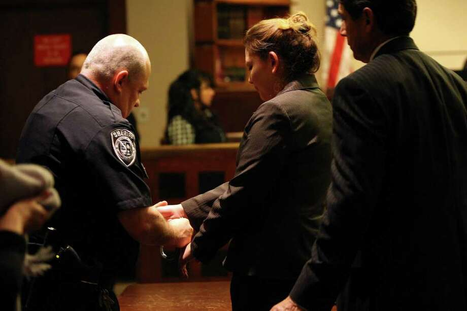 Jenny Ann Ybarra is taken into custody after she is found guilty in her intoxication manslaughter and assault trial in the 437th District Court, Monday, Feb. 13, 2012. Ybarra is on trial for the death of Erica Nicole Smith, 23, on December 2007. Ybarra is accused of driving the wrong way on Loop 410 and colliding with a car in which Smith a passenger. She was taken into custody and sentencing phase will start Tuesday. She faces a possible 20-year sentence. Photo: Jerry Lara, San Antonio Express-News / © San Antonio Express-News