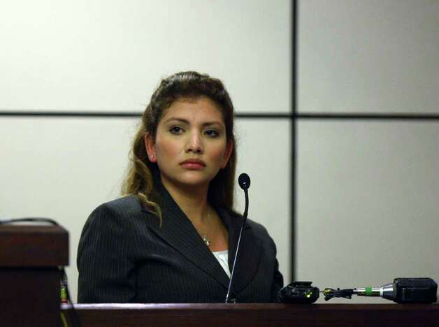 Jenny Ann Ybarra, 32, is cross-examined during her intoxication manslaughter trial in the 437th District Court, Monday, Feb. 13, 2012. Ybarra is accused of killing Erica Nicole Smith, 23, in an accident along Loop 410 in December 2007. Ybarra was driving the wrong way when she collided with a car in which Smith as a passenger. Final arguments were to begin after a lunch break. Photo: Jerry Lara, San Antonio Express-News / © 2012 San Antonio Express-News