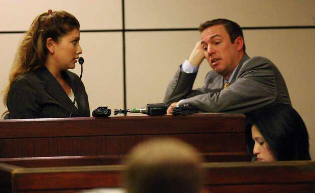 Jenny Ann Ybarra, 32, is cross-examined by prosecutor Clayton Haden, during her intoxication manslaughter trial in the 437th District Court, Monday, Feb. 13, 2012. Ybarra is accused of killing Erica Nicole Smith, 23, in an accident along Loop 410 in December 2007. Ybarra was driving the wrong way when she collided with a car in which Smith as a passenger. Final arguments were to begin after a lunch break. Photo: Jerry Lara, San Antonio Express-News / © 2012 San Antonio Express-News
