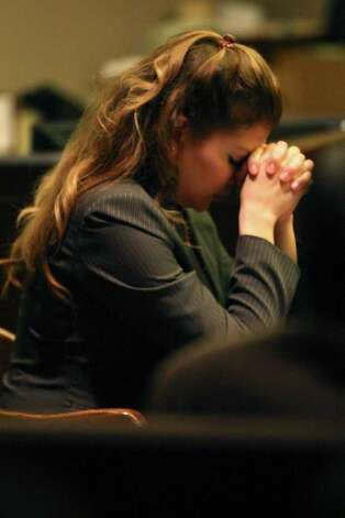 Jenny Ann Ybarra, 32, bows her head during closing arguments during her intoxication manslaughter trial in the 437th District Court, Monday, Feb. 13, 2012. Ybarra is on trial for the death of Erica Nicole Smith, 23, on December 2007. Ybarra is accused of driving the wrong way on Loop 410 and colliding with a car in which Smith a passenger. Photo: Jerry Lara, San Antonio Express-News / © San Antonio Express-News
