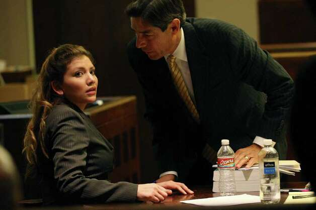 Jenny Ann Ybarra, 32, talks with her attorney, Roy Barrera, Jr., after the jury leaves the courtroom for deliberation in her intoxication manslaughter trial in the 437th District Court, Monday, Feb. 13, 2012. Ybarra is on trial for the death of Erica Nicole Smith, 23, on December 2007. Ybarra is accused of driving the wrong way on Loop 410 and colliding with a car in which Smith a passenger. Photo: Jerry Lara, San Antonio Express-News / © San Antonio Express-News