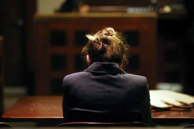 Jenny Ann Ybarra bows her head and cries after she is found guilty in her intoxication manslaughter and assault trial in the 437th District Court, Monday, Feb. 13, 2012. Ybarra is on trial for the death of Erica Nicole Smith, 23, on December 2007. Ybarra is accused of driving the wrong way on Loop 410 and colliding with a car in which Smith a passenger. She was taken into custody and sentencing phase will start Tuesday. She faces a possible 20-year sentence. Photo: Jerry Lara, San Antonio Express-News / © San Antonio Express-News