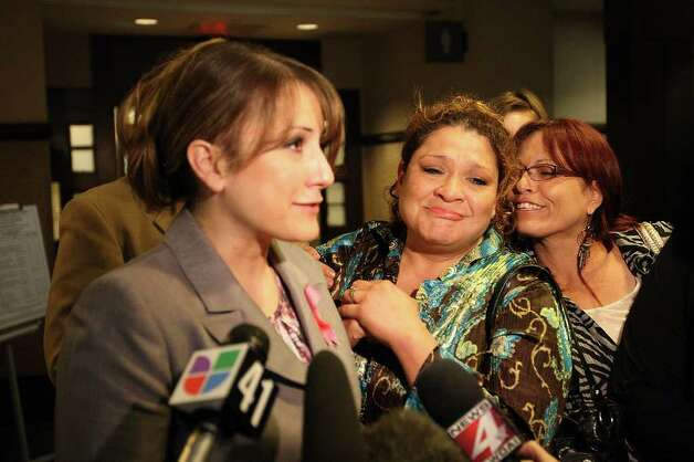 From left, Kimberly McGuire, Debbie Devries and Ginger Garcia react after  Jenny Ann Ybarra is found guilty in the intoxication manslaughter and assault trial in the 437th District Court, Monday, Feb. 13, 2012. Ybarra is on trial for the death of Erica Nicole Smith, 23, on December 2007. Ybarra is accused of driving the wrong way on Loop 410 and colliding with a car in which Smith a passenger. She was taken into custody and sentencing phase will start Tuesday. She faces a possible 20-year sentence. McGuire was the victim's cousin and Devries was the aunt. Garcia is a family friend. Photo: Jerry Lara, San Antonio Express-News / © San Antonio Express-News