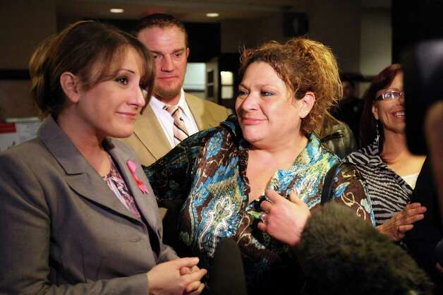 From left, Kimberly McGuire and Debbie Devries react after  Jenny Ann Ybarra is found guilty in the intoxication manslaughter and assault trial in the 437th District Court, Monday, Feb. 13, 2012. Ybarra is on trial for the death of Erica Nicole Smith, 23, on December 2007. Ybarra is accused of driving the wrong way on Loop 410 and colliding with a car in which Smith a passenger. She was taken into custody and sentencing phase will start Tuesday. She faces a possible 20-year sentence. McGuire was the victim's cousin and Devries was the aunt. Photo: Jerry Lara, San Antonio Express-News / © San Antonio Express-News