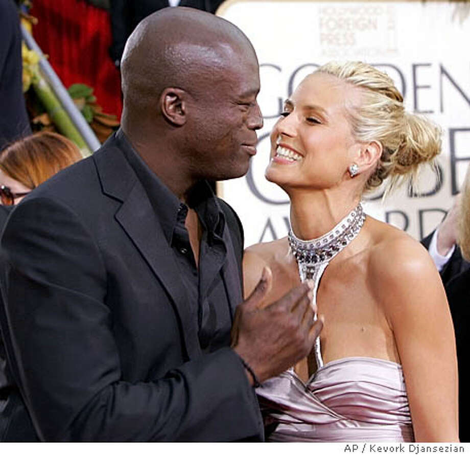 Musician Seal and his wife, Heidi Klum, appear on the red carpet before the 63rd Annual Golden Globe Awards on Monday, Jan. 16, 2006, in Beverly Hills, Calif. (AP Photo/Kevork Djansezian) Photo: KEVORK DJANSEZIAN
