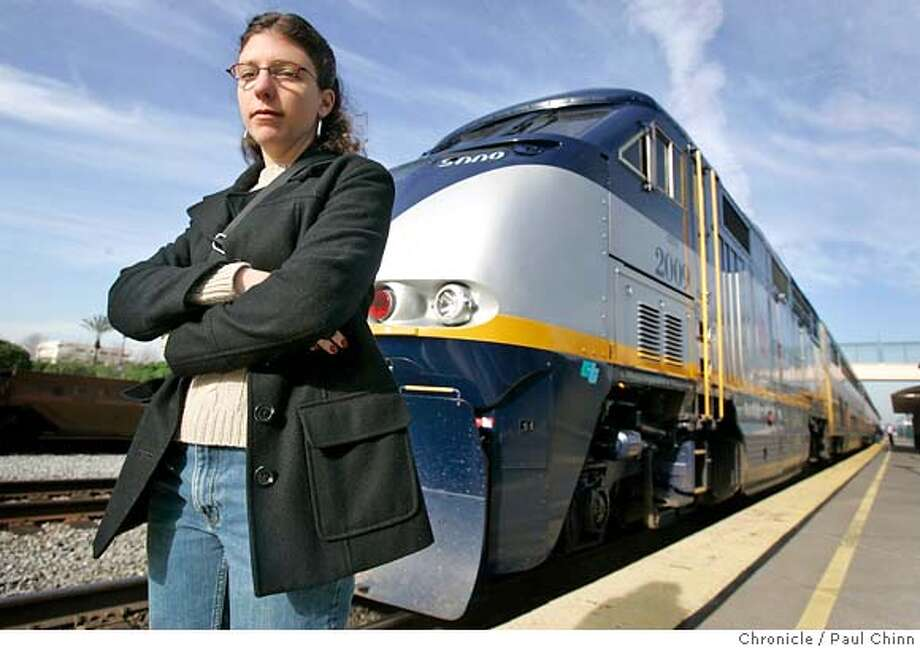 Former train conductor Rebecca Gettleman stands on the platform as an Amtrak train pulls into the station in Emeryville, Calif. on 1/5/06. Gettleman says she was fired when Amtrak officials declared that she was accident-prone after she twisted her wrist helping save a drunk passenger from stumbling headfirst down train stairs.  PAUL CHINN/The Chronicle Photo: PAUL CHINN