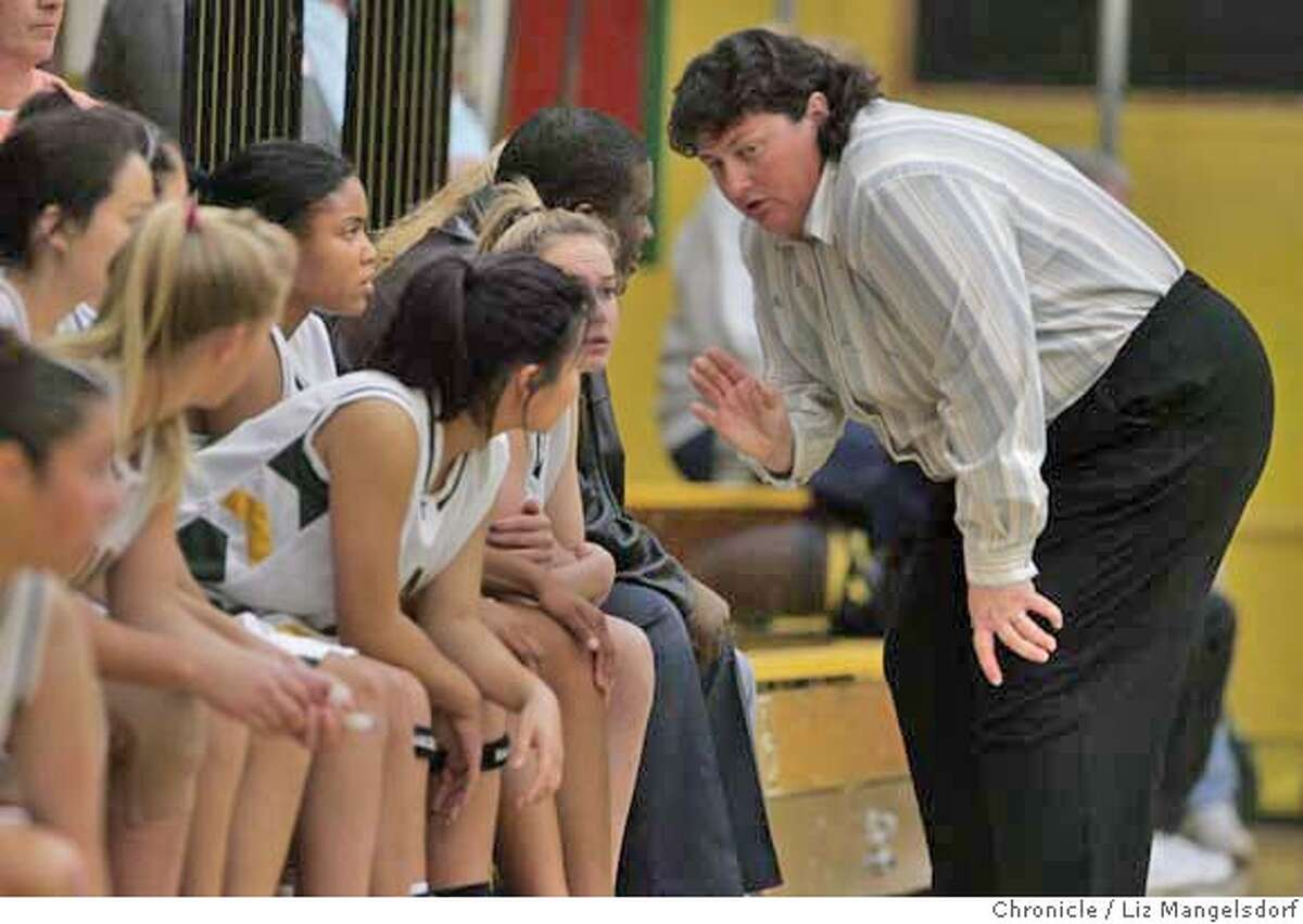 Castro Valley High School Girl's Basketball coach Nancy Nibarger talks with her players on the sidelines during the game against the Foothills High School Falcons. Nibarger has had problems with parents of some students who were trying out for her team. Photographed at Castro Valley High School on Nov. 28, 2006. Liz Mangelsdorf / The Chronicle MANDATORY CREDIT FOR PHOTOG AND SF CHRONICLE/ -MAGS OUT