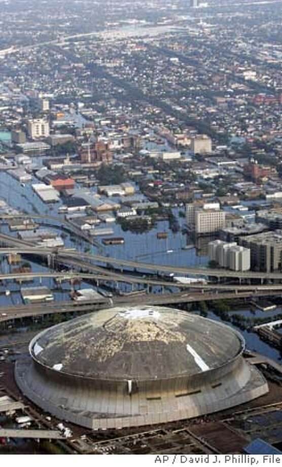 The Louisiana Superdome, which was damaged by Hurricane Katrina, sits surrounded by floodwaters Tuesday, Aug. 30, 2005 in New Orleans. (AP Photo/David J. Phillip) Ran on: 09-01-2005  Katrina left the Louisiana Superdome with massive holes, surrounded by water, and with little chance of housing the Saints. Ran on: 09-01-2005  Katrina left the Louisiana Superdome with massive holes, surrounded by water, and with little chance of housing the Saints. Photo: DAVID J. PHILLIP