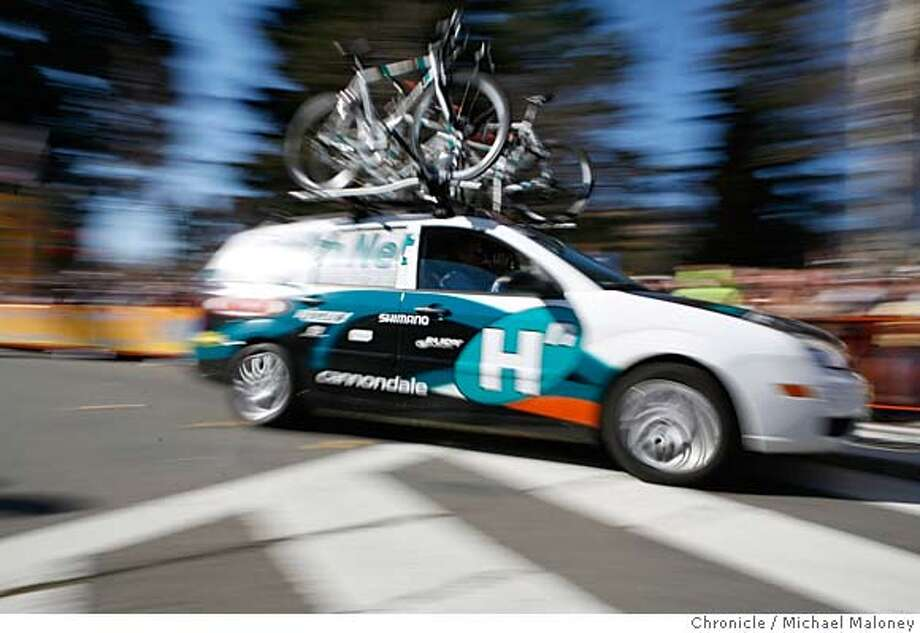BIKE_153_MJM.jpg  Team Health Net's team car speeds through the streets of Santa Rosa, chasing the peloton.  Stage 1 of the Amgen Tour of California bicycle race.  An 81 mile race from Sausalito to Santa Rosa via scenic Highway 1.  Photo by Michael Maloney / San Francisco Chronicle on 2/20/06 in San Francisco,CA Photo: Michael Maloney