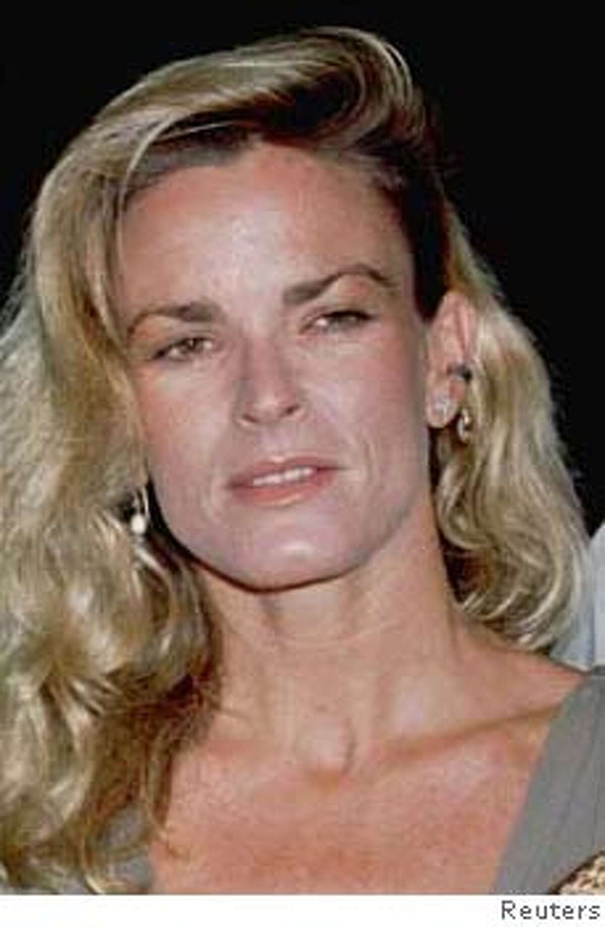 """LOA02:SIMPSON:LOS ANGELES,15JUN94- FILE PHOTO MAR94- Nicole Simpson, ex-wife of O.J. Simpson, is shown at the March 16, 1994, premiere of O. J. Simpson's new film """"Naked Gun 33 1/3:The Final Insult,"""" in Los Angeles. Nicole Simpson and a male companion, Ronald Goldman, were found murdered June 12 in Los Angeles. fsp/str-Fred Prouser REUTER ALSO RAN: 11/22/96 CAT"""