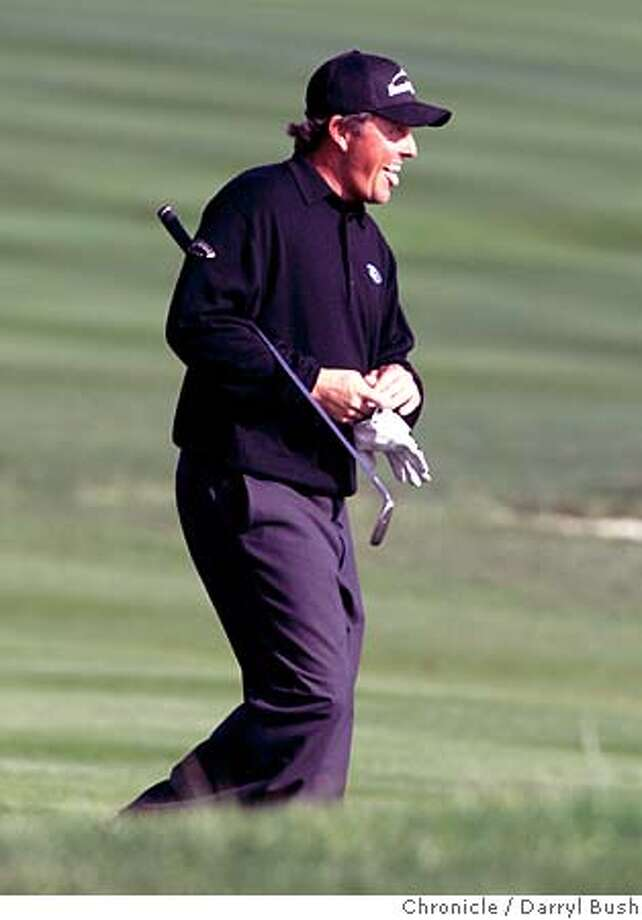 at&t_0515_db.JPG  Phil Mickelson reacts to a chip shot to the green at Pebble Beach Golf Links as he finishes his round on the 18th hole in the third round of play at AT&T Pebble Beach National Pro-Am at Pebble Beach.  Event on 2/11/06 in Pebble Beach.  Darryl Bush / The Chronicle MANDATORY CREDIT FOR PHOTOG AND SF CHRONICLE/ -MAGS OUT Photo: Darryl Bush