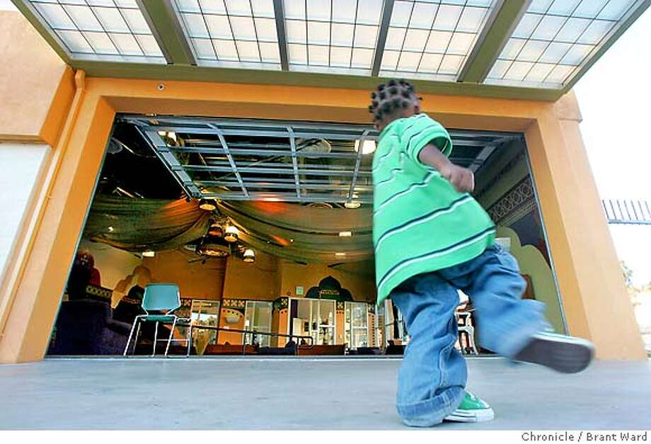 place078_ward.jpg  One of the architectural benefits of the center are the large windows that roll up allowing for large outside patio areas for dancing and gathering. Here, Amir, a four year old child of one of the centers workers plays on the cement patio.  Youth Uprising, an old Safeway store converted to a youth center, is located next to Castlemont High School in east Oakland. This is an after school hub for many of the inner-city school students.  Brant Ward1/23/06 Photo: Brant Ward