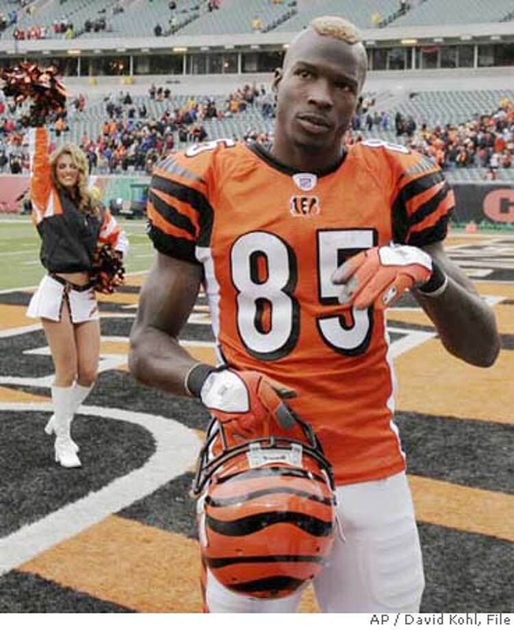 Cincinnati Bengals receiver Chad Johnson leaves the field following their win over the Carolina Panthers in an NFL football game, Sunday, Oct. 22, 2006, in Cincinnati. Johnson and Atlanta Falcons cornerback DeAngelo Hall have turned their matchup this Sunday in Cincinnati into a long-awaited matchup. (AP Photo/David Kohl) Photo: DAVID KOHL