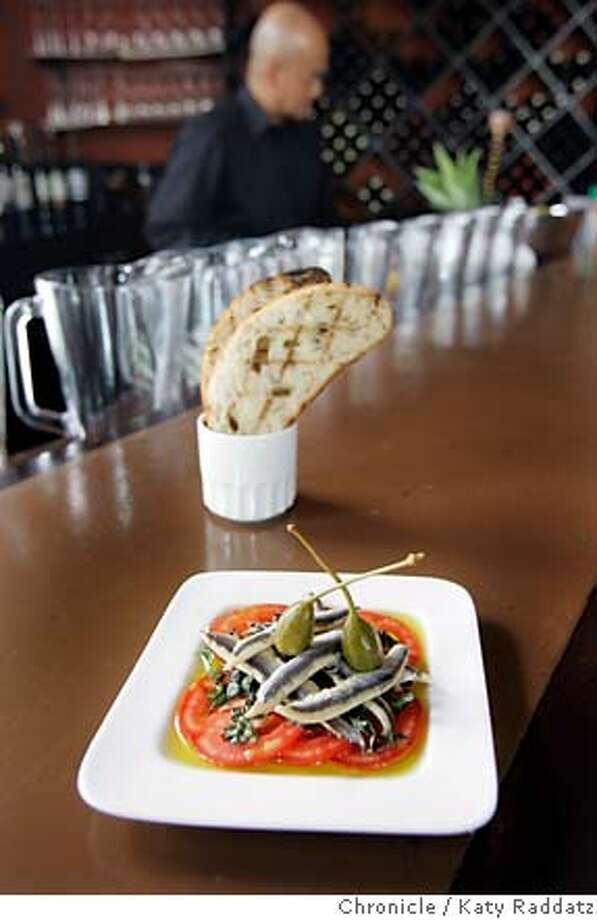 d.15SPANISHFLY_005_RAD.jpg  SHOWN: Tostada de Boquerones served at the bar. Spanish Fly is a new tapas restaurant in San Francisco that took over the spot on Geary at Parker Sts. that Straits Cafe once occupied. These pictures were made on Tuesday, Sept. 26, 2006, in San Francisco, CA.  (Katy Raddatz/The S.F.Chronicle)  **Tostada de Boquernoes Mandatory credit for photographer and the San Francisco Chronicle/ -Mags out Photo: Katy Raddatz