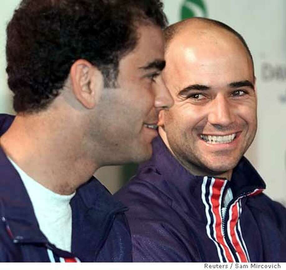 LOA04D:SPORT-DAVIS CUP-US:INGLEWOOD,CALIFORNIA,6APR00 - United States Davis Cup team member Andre Agassi (R) smiles as teammate Pete Sampras answers media questions at a press conference at the Great Western Forum in Inglewood, California, April 6. The US team will face the Czech Republic team April 7. ssm/Photo by Sam Mircovich REUTERS also ran 08/25/03  Ran on: 09-13-2006  Andre Agassi (right) won the French Open, a title that eluded Pete Sampras.  Ran on: 09-13-2006  Andre Agassi (right) won the French Open, a title that eluded Pete Sampras.  Ran on: 09-13-2006 Ran on: 09-13-2006 Photo: SAM MIRCOVICH