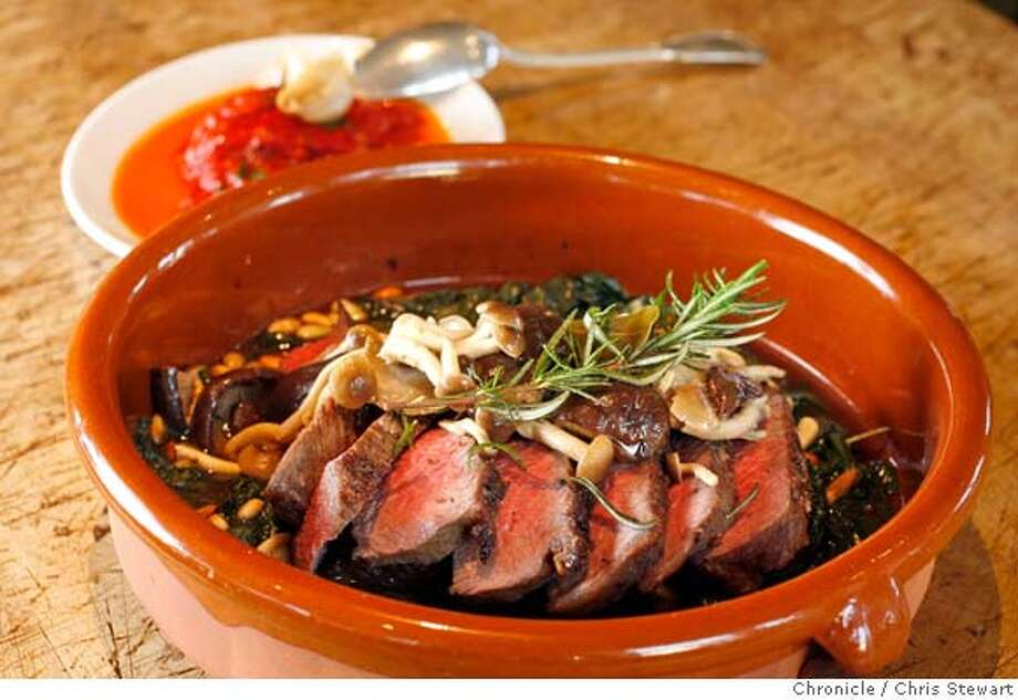 """d.29 ad hoc_0022_cs.jpg Herb roasted sirloin tip with baked piquillo peppers, swiss chard with raisins and pine nutes at Ad Hoc, Thomas Keller's (French Laundry) """"temporary"""" restaurant. Located at 6476 Washington St., Yountville, it will probably become permanent. He creates one four course fixed price menu a night. Chris Stewart / The Chronicle MANDATORY CREDIT FOR PHOTOG AND SF CHRONICLE/ -MAGS OUT"""