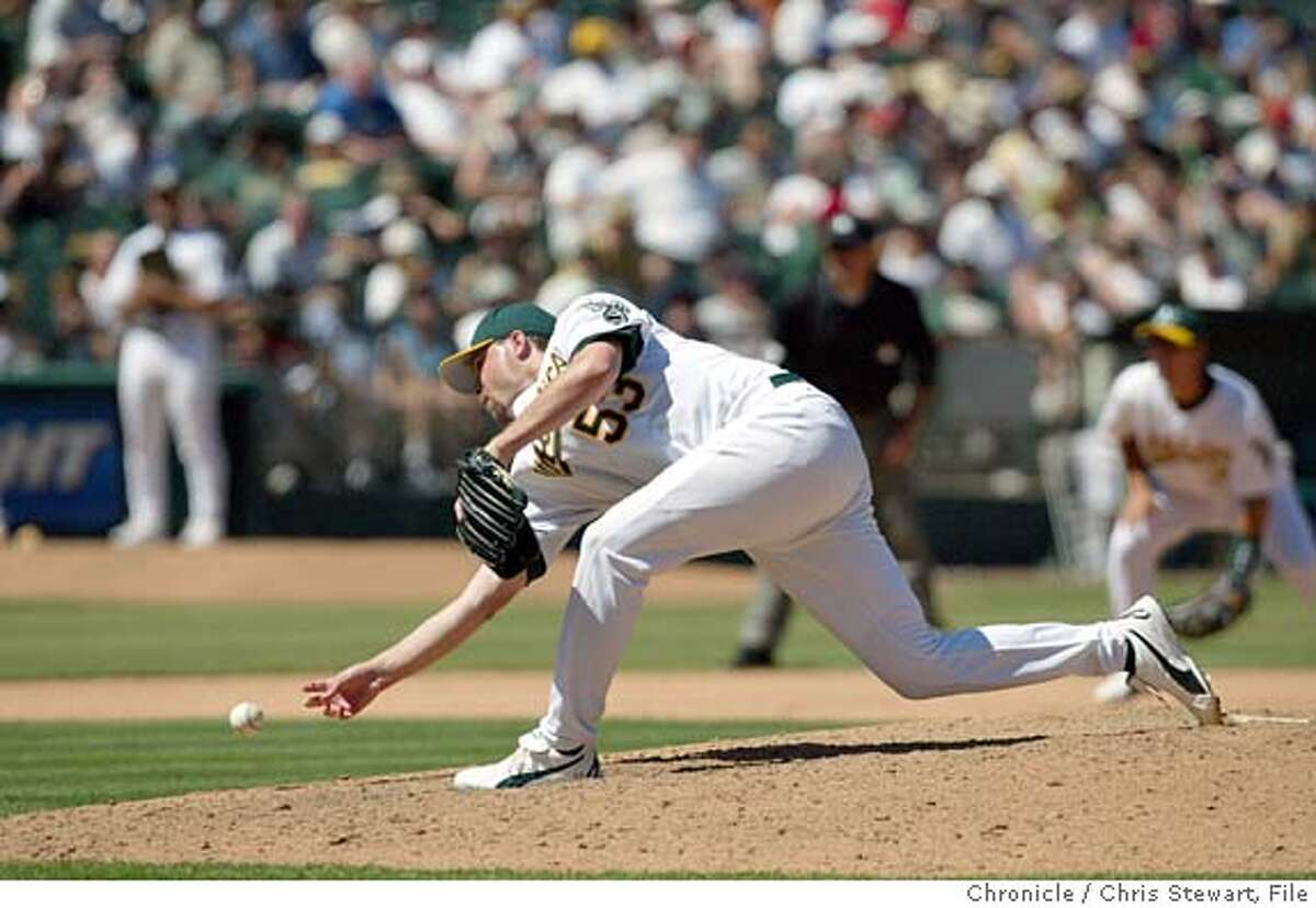 athletics218_cs.jpg Event on 8/16/03 in Oakland. Oakland A's pitcher Chad Bradford (53). The A's hung onto a lead and beat the Toronto Bluejays 6-4 at the Network Associates Coliseum CHRIS STEWART / The Chronicle MANDATORY CREDIT FOR PHOTOG AND SF CHRONICLE/ -MAGS OUT