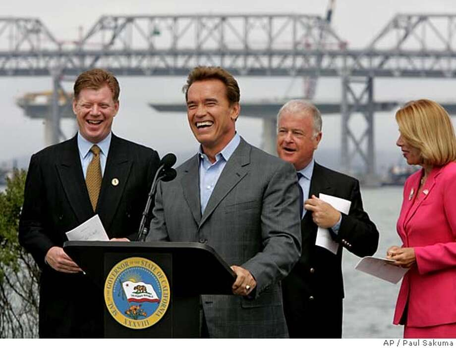 Calif. Gov. Arnold Schwarzenegger, center, laughs as he talks about bipartisan legislation that he just signed in front of the San Francisco-Oakland Bay Bridge in Oakland, Calif., Monday, July 18, 2005, to complete and finance the construction of the new San Francisco-Oakland Bay Bridge. Smiliing in background is Calif. Business, Transportation and Housing Secretary Sunne McPeak, right; Calif. Sen. Don Perata, D-Oakland, center right; and Calif. Assemblyman Guy Houston, R-San Ramon. (AP Photo/Paul Sakuma) Photo: PAUL SAKUMA