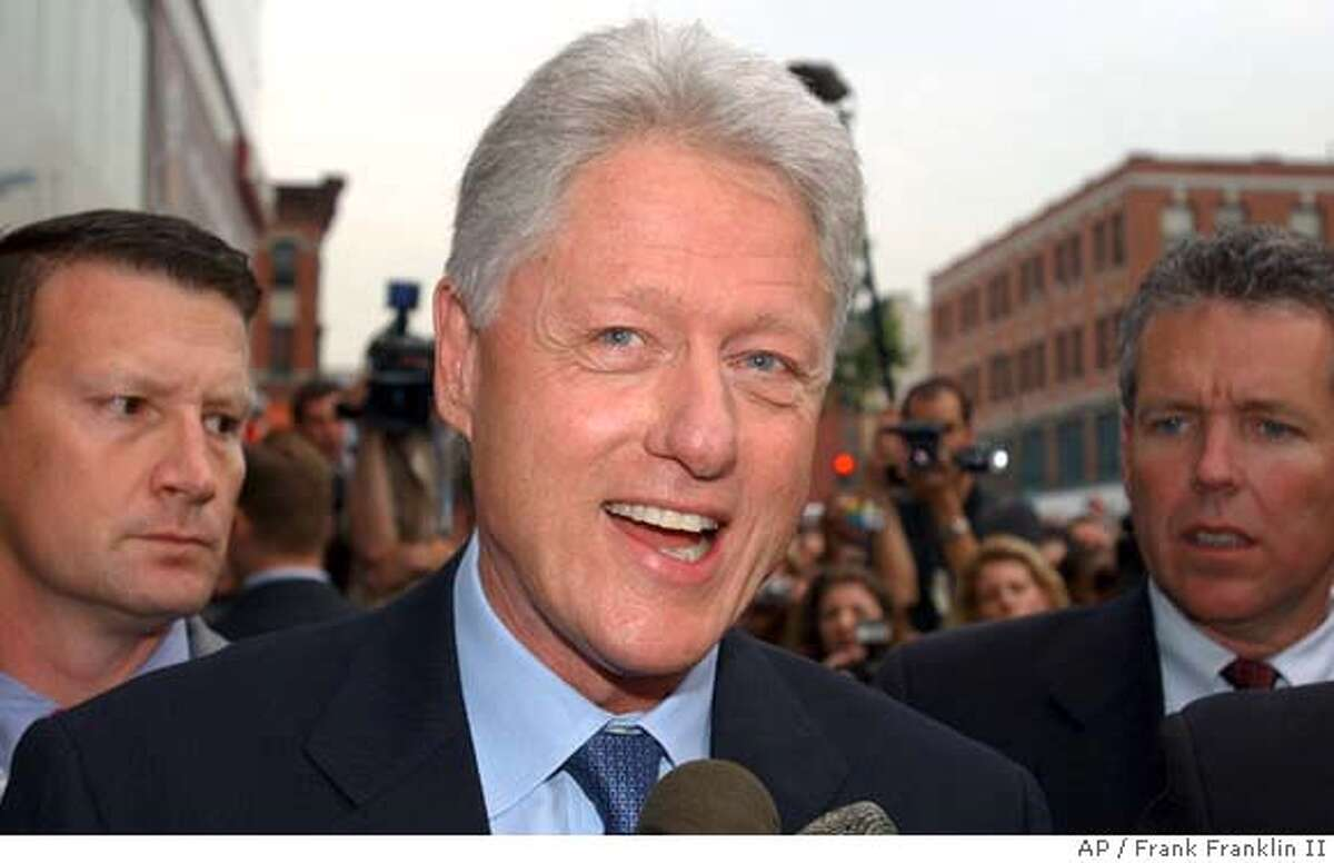Former President Bill Clinton responds to questions during a news interview before signing copies of his book entitled