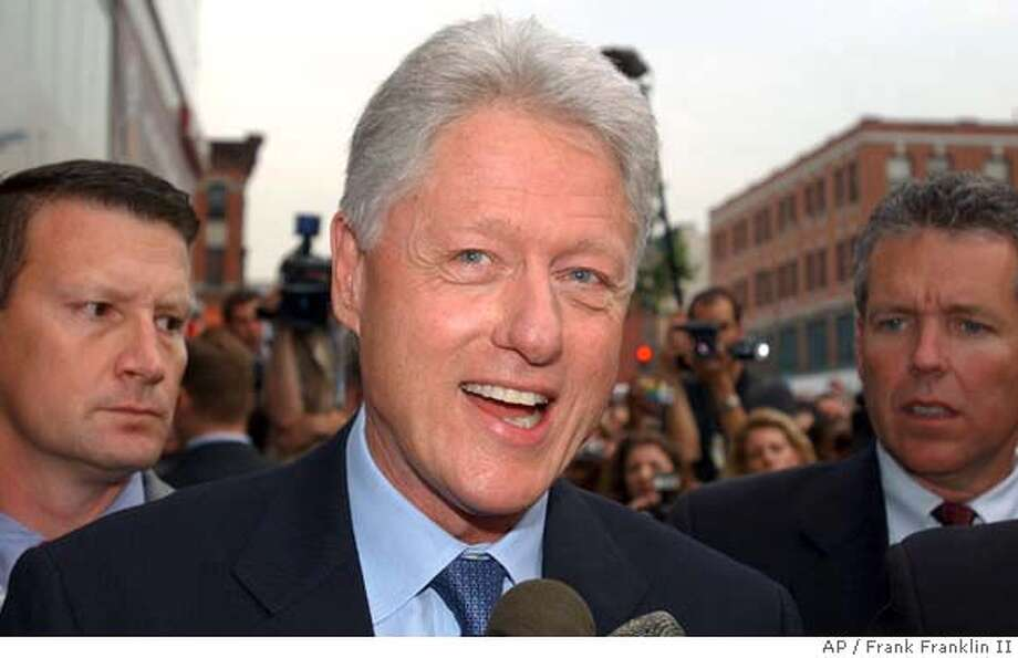 "Former President Bill Clinton responds to questions during a news interview before signing copies of his book entitled ""My Life"" at the Hue-Man bookstore in New York, Tuesday, June 22, 2004. (AP Photo/Frank Franklin II) Photo: FRANK FRANKLIN II"