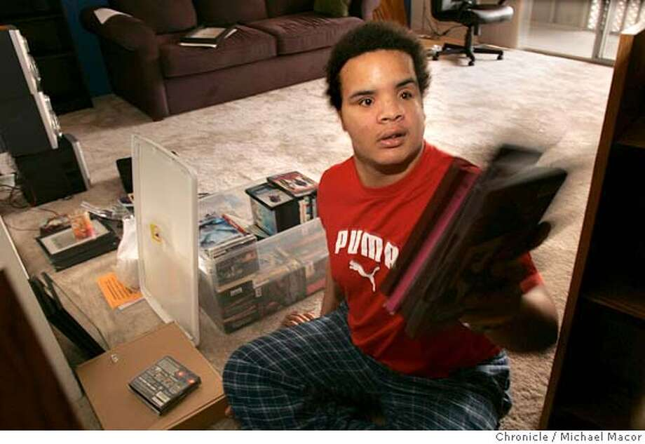 nevius24_022_mac.jpg Jason unpacks his belongings inside the new apartment he just moved into. Jason Poole is a Iraq war vet who arrived at Palo Alto Veterans center unable to walk, talk, or breathe on his own. He'd been in a terrible explosion that killed the three people he was with. He's gradually re-learned speech, can walk, and this week is, for the first time, moving into an apartment on his own. This will be his first Christmas on his own in three years. He's very excited about it. A story about the war, the toll, and this guy who remains optimistic and upbeat despite severe problems. Event in Cupertino, Ca on 12/22/05. Photo by: Michael Macor / San Francisco Chronicle Mandatory Credit for Photographer and San Francisco Chronicle/ - Magazine Out Photo: Michael Macor