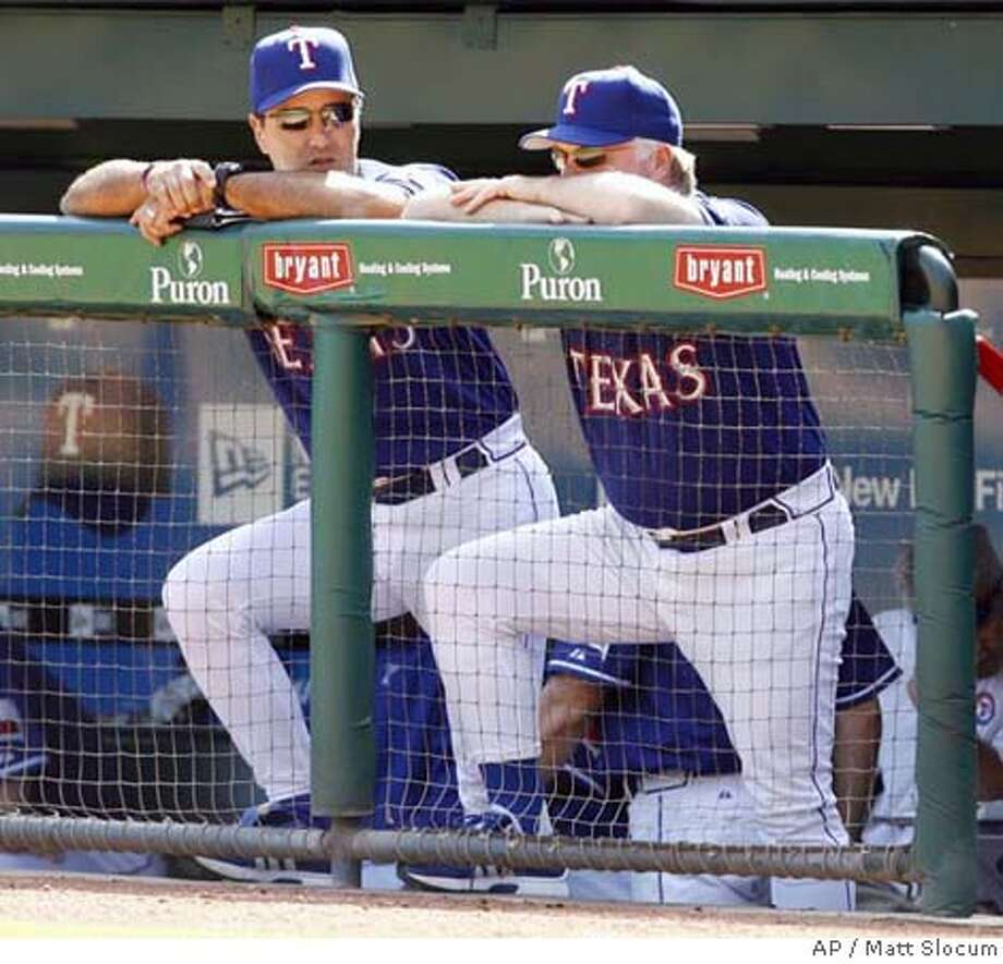Texas Rangers manager Buck Showalter, right, and bench coach Don Wakamatsu watch from the dugout as the Rangers lose to the Cleveland Indians, 11-6, in their final home game of the season, Sunday, Sept. 24, 2006, in Arlington, Texas. Showalter was fired as manager of the Texas Rangers on Wednesday, ending four seasons in which he was never able to get a team with several young All-Stars above third place in the AL West. (AP Photo/Matt Slocum) A SEPT. 24, 2006 PHOTO Photo: MATT SLOCUM