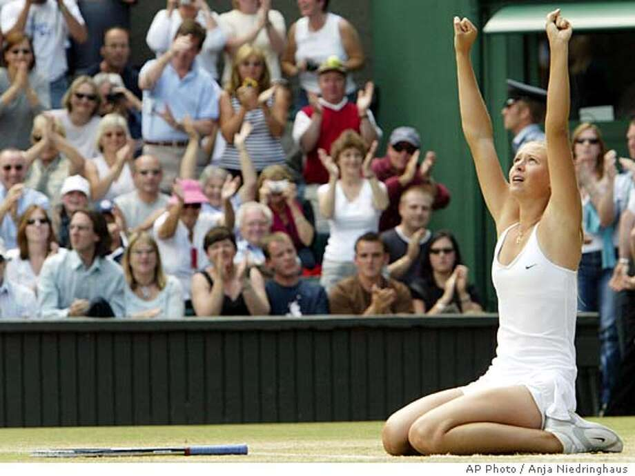 Russia's Maria Sharapova reacts at match point over Serena Williams, at the end of their Women's Singles, final match on the Centre Court at Wimbledon, Saturday July 3, 2004. Sharapova won 6-1, 6-4. (AP Photo/Anja Niedringhaus) ** EDITORIAL USE ONLY ** Photo: ANJA NIEDRINGHAUS