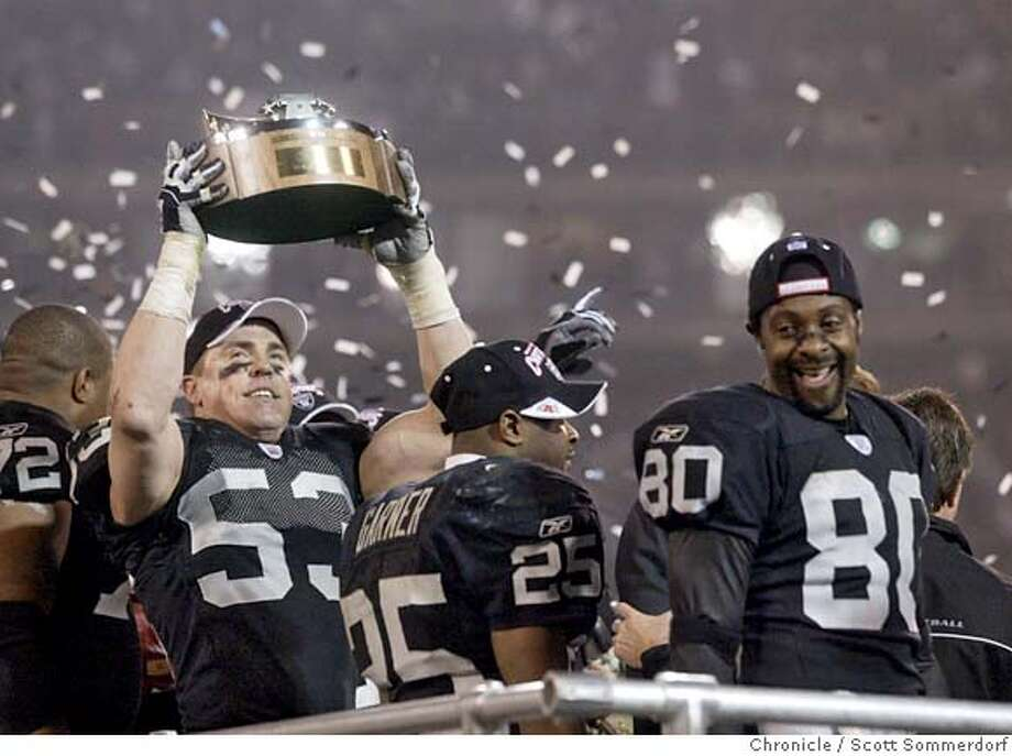 df68d3e55 OAKLAND2-c-19JAN03-SP-SS LB Bill Romanowski raises the AFC trophy