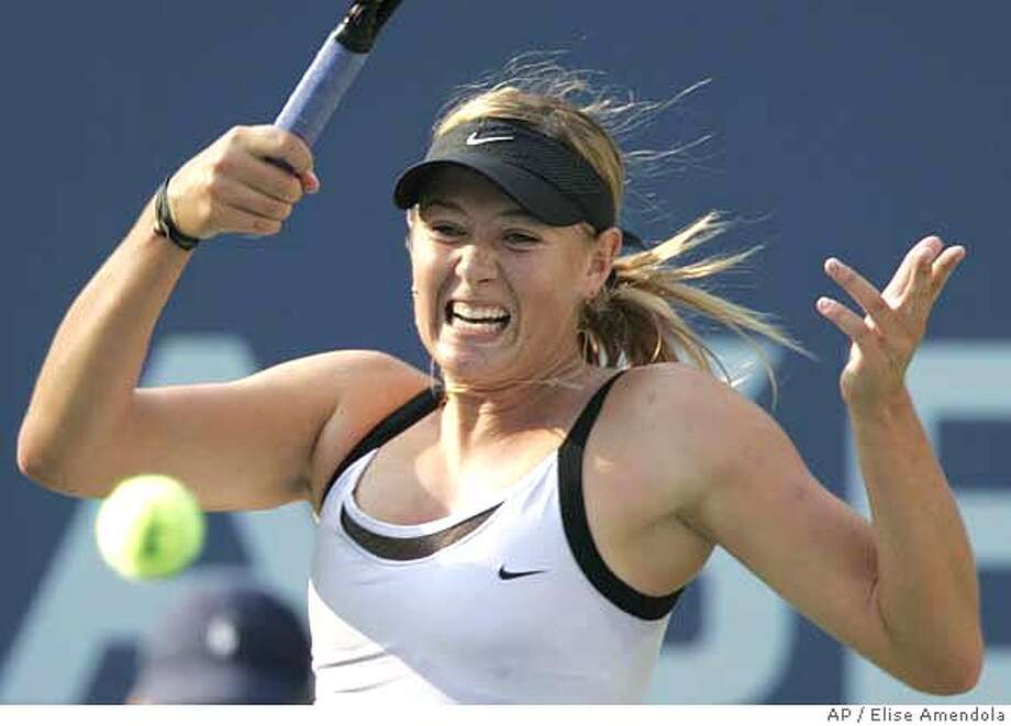 Maria Sharapova, of Russia, makes a return against Amelie Mauresmo, of France, at the US Open tennis tournament in New York, Friday, Sept. 8, 2006. (AP Photo/Elise Amendola) Photo: ELISE AMENDOLA
